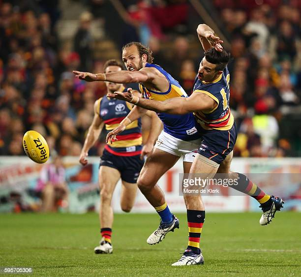 Will Schofield of the Eagles competes with Taylor Walker of the Crows during the round 23 AFL match between the Adelaide Crows and the West Coast...