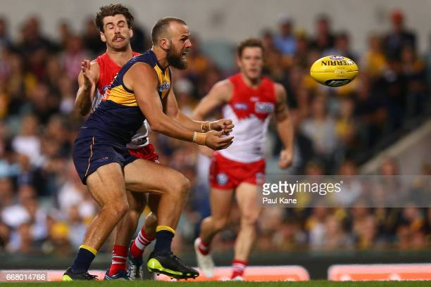 Will Schofield of the Eagles handballs during the round four AFL match between the West Coast Eagles and the Sydney Swans at Domain Stadium on April...