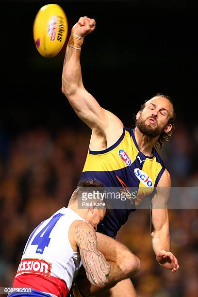 Will Schofield of the Eagles punches the ball clear against during the Second Elimination Final match between the West Coast Eagles and the Western...