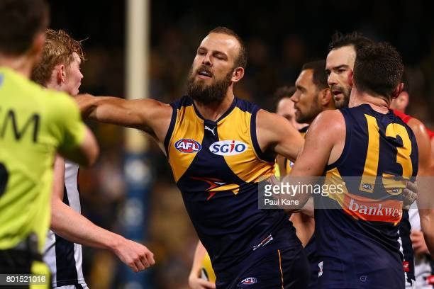 Will Schofield of the Eagles raises his forearm towards Clayton Oliver of the Demons at the end of the second quarter during the round 14 AFL match...