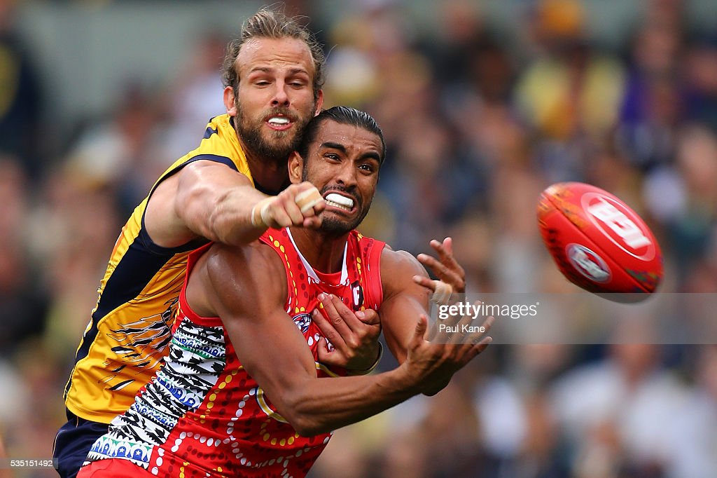 Will Schofield of the Eagles spoils the mark for Tom Nicholls of the Suns during the round 10 AFL match between the West Coast Eagles and the Gold Coast Suns at Domain Stadium on May 29, 2016 in Perth, Australia.