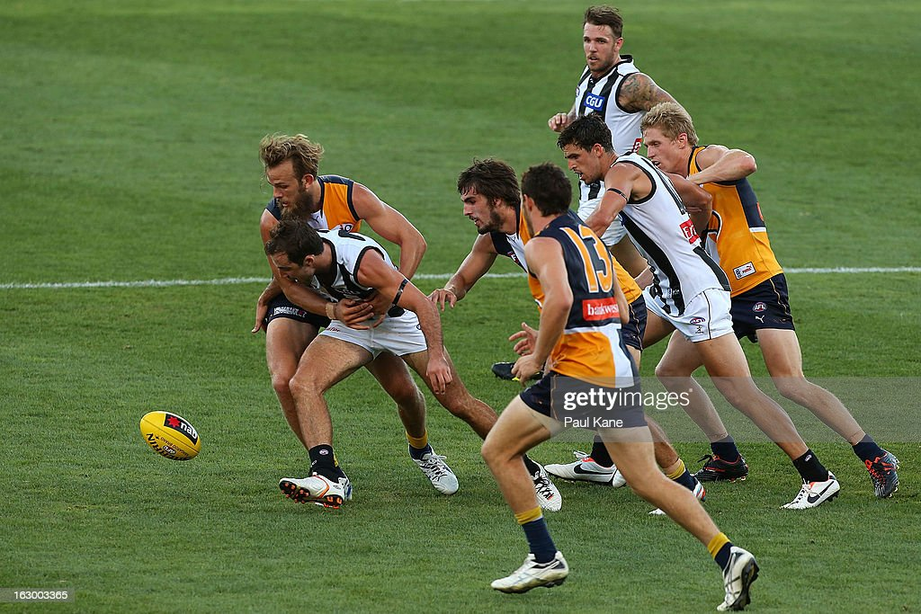 Will Schofield of the Eagles tackles Steele Sidebottom of the Magpies during the round two AFL NAB Cup match between the West Coast Eagles and the Collingwood Magpies at Patersons Stadium on March 3, 2013 in Perth, Australia.