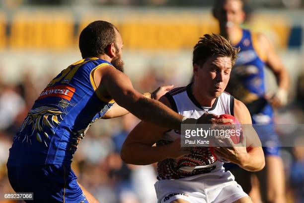 Will Schofield of the Eagles tackles Toby Greene of the Giants during the round 10 AFL match between the West Coast Eagles and the Greater Western...