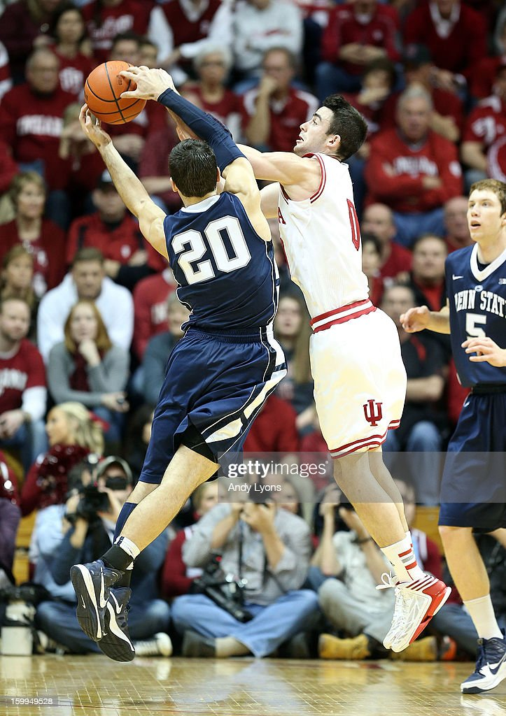 Will Sheehey #0 of the Indiana Hoosiers and Nick Colella #20 of the Penn State Nittany Lions reach for a loose ball during the game at Assembly Hall on January 23, 2013 in Bloomington, Indiana.