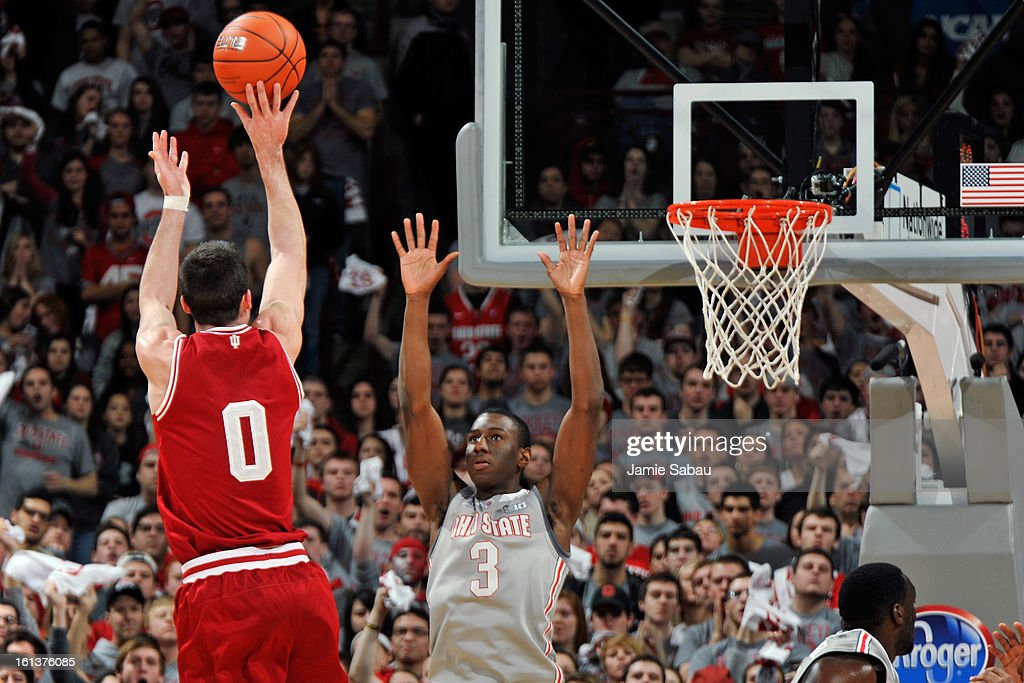Will Sheehey #0 of the Indiana Hoosiers puts up a three-point shot over Shannon Scott #3 of the Ohio State Buckeyes in the second half on February 10, 2013 at Value City Arena in Columbus, Ohio. Indiana defeated Ohio State 81-68.
