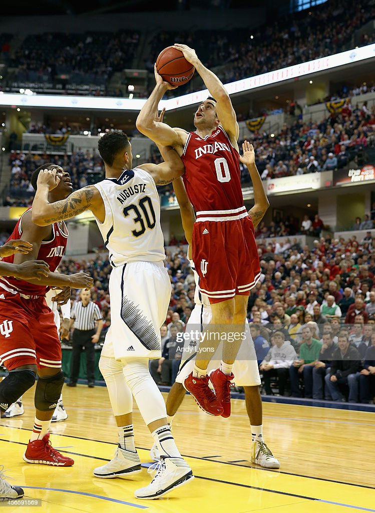 Will Sheehey #0 of the Indiana Hoosiers shoots the ball in the game against the Notre Dame Fighting Irish during the 2013 Crossroads Classic at Bankers Life Fieldhouse on December 14, 2013 in Indianapolis, Indiana.
