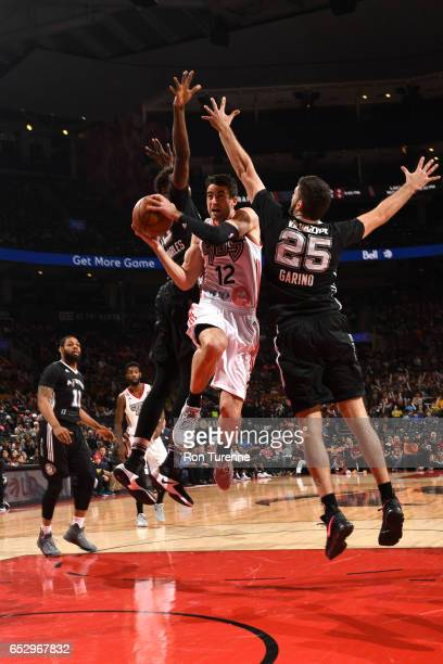 Will Sheehey of the Raptors 905 goes up for the shot against Patricio Garino of the Austin Spurs at the Air Canada Centre on March 13 2017 in Toronto...