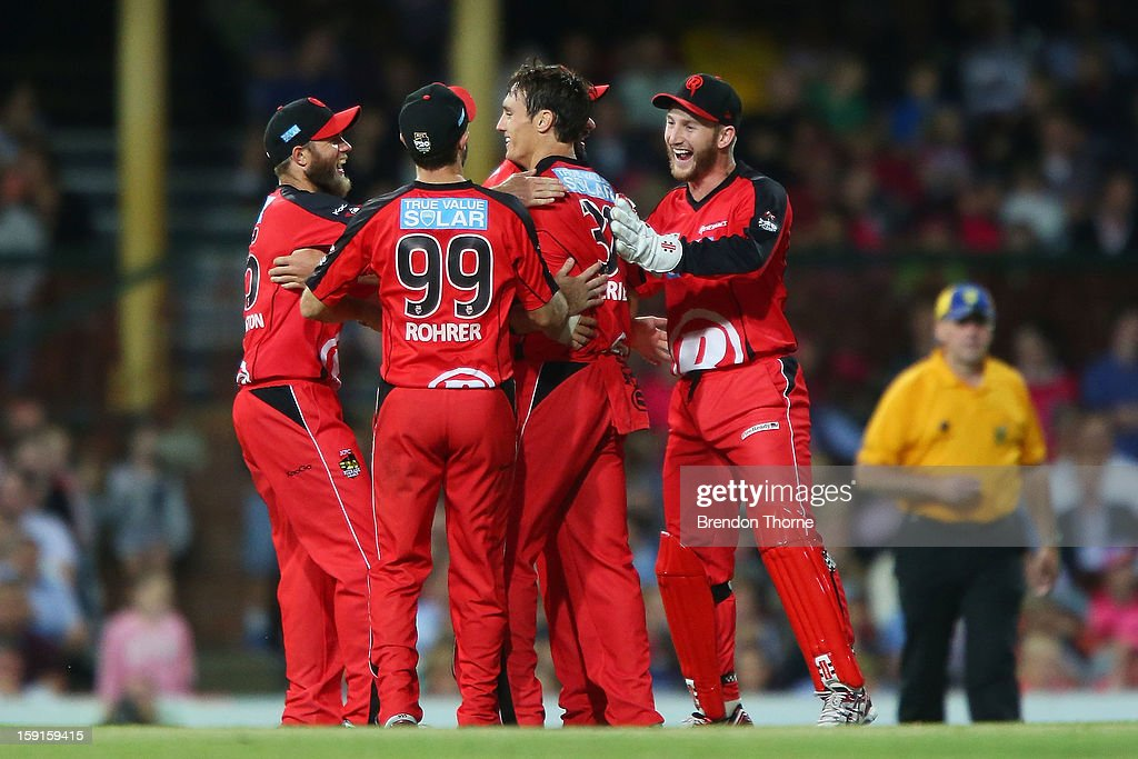 Will Sheridan of the Renegades celebrates with team mates after claiming the wicket of Daniel Hughes of the Sixers during the Big Bash League match between the Sydney Sixers and the Melbourne Renegades at SCG on January 9, 2013 in Sydney, Australia.
