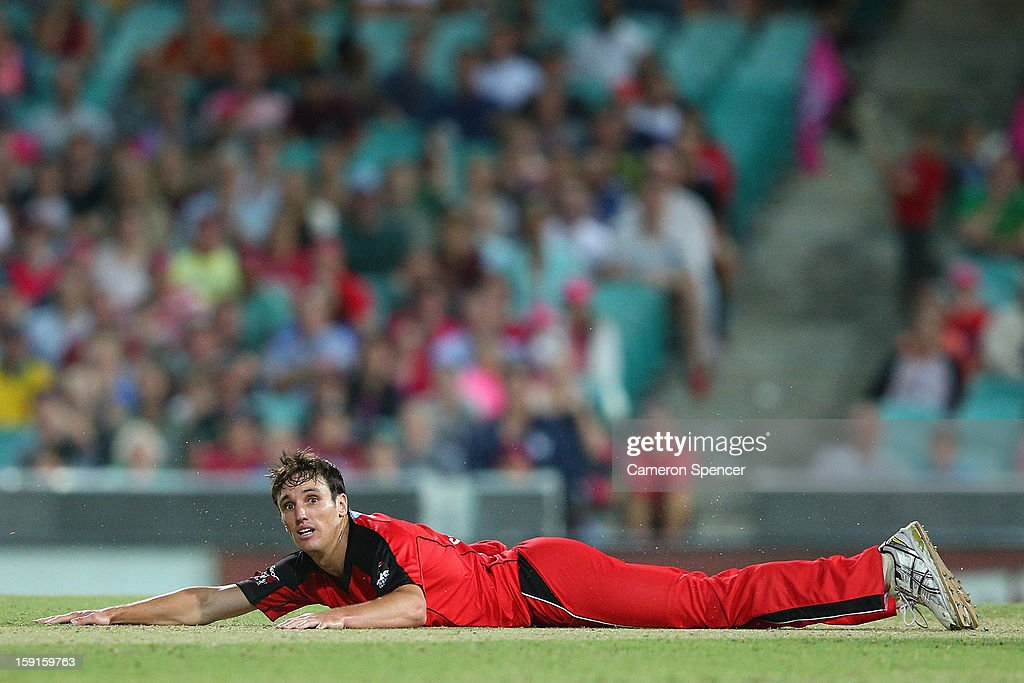 Will Sheridan of the Renegades falls to the pitch as he bowls during the Big Bash League match between the Sydney Sixers and the Melbourne Renegades at SCG on January 9, 2013 in Sydney, Australia.