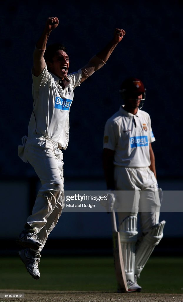 Will Sheridan of the Victorian Bushrangers celebrates his dismissal of <a gi-track='captionPersonalityLinkClicked' href=/galleries/search?phrase=Nathan+Hauritz&family=editorial&specificpeople=224541 ng-click='$event.stopPropagation()'>Nathan Hauritz</a> of the Queensland Bulls during day one of the Sheffield Shield match between the Victorian Bushrangers and the Queensland Bulls at Melbourne Cricket Ground on February 18, 2013 in Melbourne, Australia.