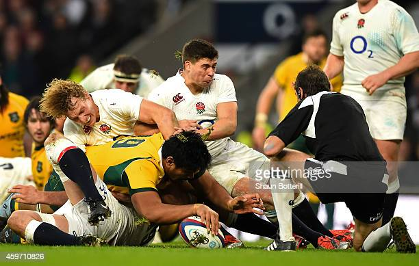 Will Skelton of Australia breaks through the England defence to score his team's second try during the QBE international match between England and...
