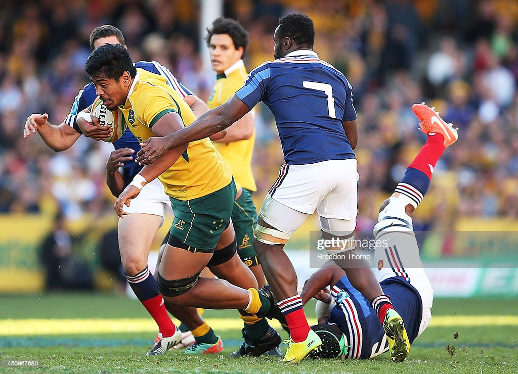 Will Skelton of the Wallabies is tackled by <a gi-track='captionPersonalityLinkClicked' href=/galleries/search?phrase=Thierry+Dusautoir&family=editorial&specificpeople=544025 ng-click='$event.stopPropagation()'>Thierry Dusautoir</a> and <a gi-track='captionPersonalityLinkClicked' href=/galleries/search?phrase=Fulgence+Ouedraogo&family=editorial&specificpeople=3958946 ng-click='$event.stopPropagation()'>Fulgence Ouedraogo</a> of France during the International Test match between the Australia Wallabies and France at Allianz Stadium on June 21, 2014 in Sydney, Australia.