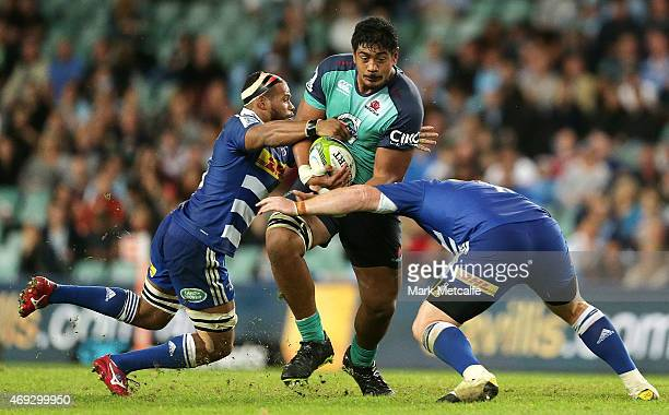 Will Skelton of the Waratahs is tackled by Nizaam Carr and Steven Kitshoff of the Stormers during the round nine Super Rugby match between the...