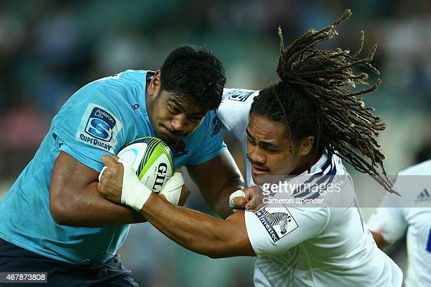 Will Skelton of the Waratahs is tackled by Ofa Tu'Ungafasi of the Blues during the round seven Super Rugby match between the Waratahs and the Blues...