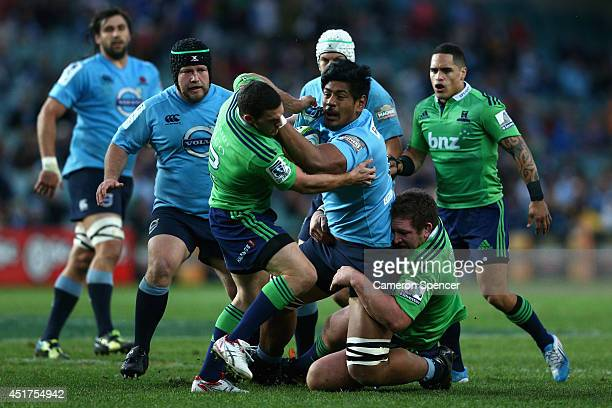 Will Skelton of the Waratahs is tackled during the round 18 Super Rugby match between the Waratahs and the Highlanders at Allianz Stadium on July 6...