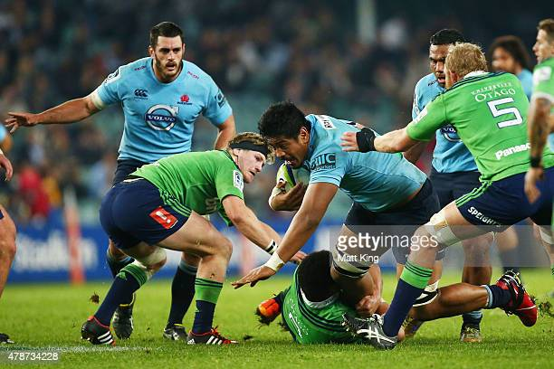 Will Skelton of the Waratahs is tackled during the Super Rugby Semi Final match between the Waratahs and the Highlanders at Allianz Stadium on June...