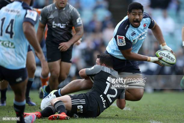 Will Skelton of the Waratahs passes as he is tackled during the round six Super Rugby match between the Waratahs and the Crusaders at Allianz Stadium...