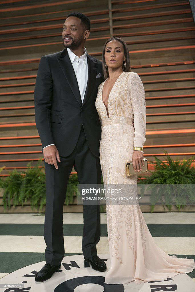 Will Smith and Jada Pinkett Smith arrive at the 2014 Vanity Fair Oscar Party on March 2, 2014 in West Hollywood, California. AFP PHOTO/ADRIAN SANCHEZ-GONZALEZ