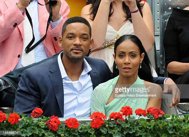 Will Smith and Jada Pinkett Smith attend the Mutua Madrilena Madrid Open on May 13 2012 in Madrid Spain