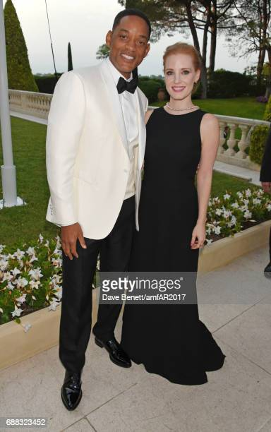 Will Smith and Jessica Chastain arrive at the amfAR Gala Cannes 2017 at Hotel du CapEdenRoc on May 25 2017 in Cap d'Antibes France