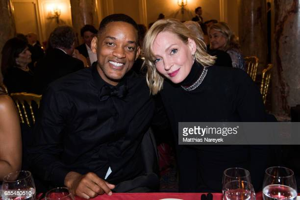 Will Smith and Uma Thurman attends Jeffrey Katzenberg Hommage At Cinema Professionals Dinner during the 70th annual Cannes Film Festival at on May 19...