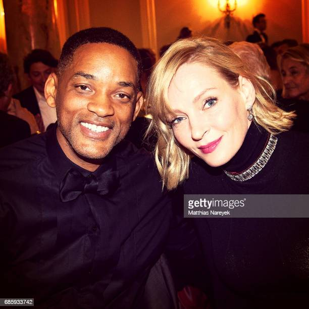 Will Smith and Uma Thurman attends Jeffrey Katzenberg Hommage At Cinema Professionals Dinner during the 70th annual Cannes Film Festival at on May 18...