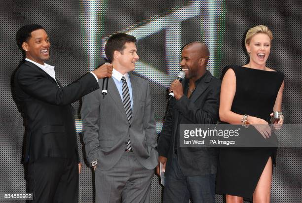 Will Smith Jason Bateman DJ Spoony and Charlize Theron on stage at the UK Film Premiere of Hancock at the Vue West End London