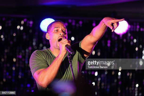 Will Smith joins Chris Martin of Coldplay on stage at a dinner party hosted by iHeartmedia and Medialink featuring a special performance by Chris...