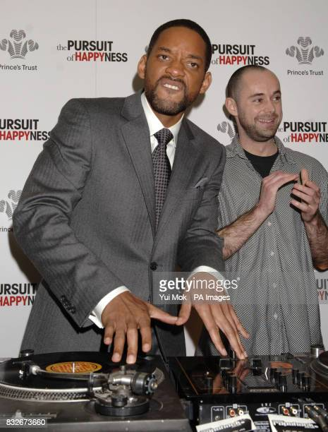 Will Smith meets DJ Adam Gibbs who is a beneficiary of the charity at a Prince's Trust charity lunch held in association with the premiere of Smith's...
