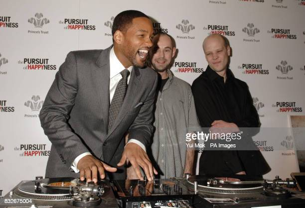 Will Smith meets DJs Adam Gibbs and Paul Everett beneficiaries of the charity during a Prince's Trust charity lunch held in association with the...