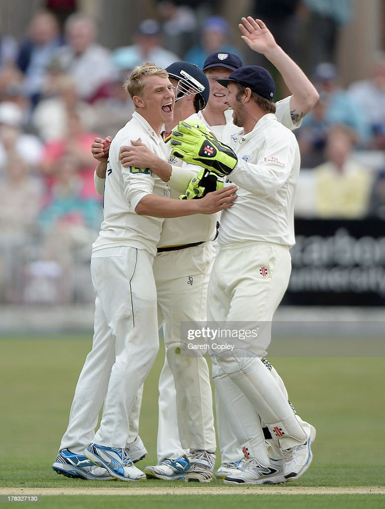 Will Smith of Durham celebrates with Scott Borthwick and <a gi-track='captionPersonalityLinkClicked' href=/galleries/search?phrase=Phil+Mustard&family=editorial&specificpeople=824851 ng-click='$event.stopPropagation()'>Phil Mustard</a> after dismissing Phil Jaques of Yorkshire during the LV County Championship division one match between Yorkshire and Durham at North Marine Road on August 29, 2013 in Scarborough, England.