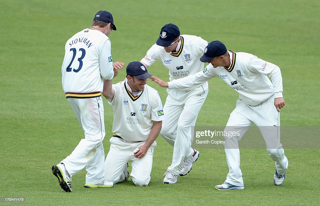 Will Smith of Durham is congratulated by teammates Mark Stoneman, <a gi-track='captionPersonalityLinkClicked' href=/galleries/search?phrase=Paul+Collingwood&family=editorial&specificpeople=204191 ng-click='$event.stopPropagation()'>Paul Collingwood</a> and Scott Borthwick after catching out Rikki Clarke of Warwickshire during day two of the LV County Championship Division One match between Durham and Warwickshire at The Riverside on June 13, 2013 in Chester-le-Street, England.