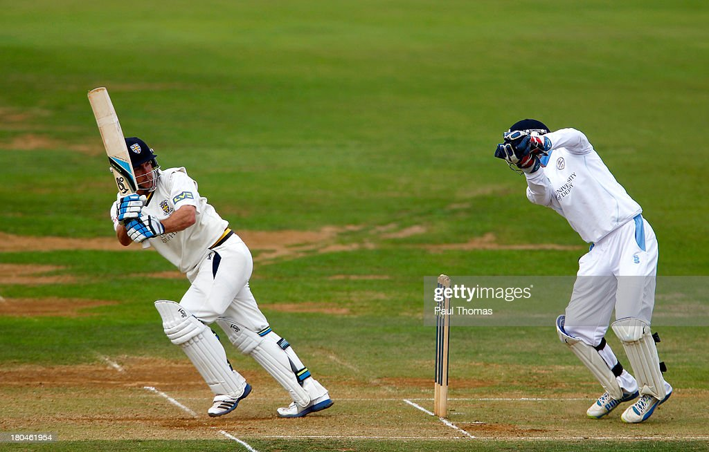 Will Smith (L) of Durham plays a shot past Derbyshire's Tom Poynton during the LV County Championship match between Derbyshire and Durham at The County Ground on September 13, 2013 in Derby, England.