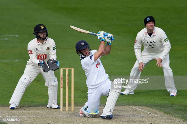 Will Smith of Hampshire hits out as wicketkeeper Craig Capocha and Chris Nash of Sussex look on during a friendly match between Sussex and Hampshire...
