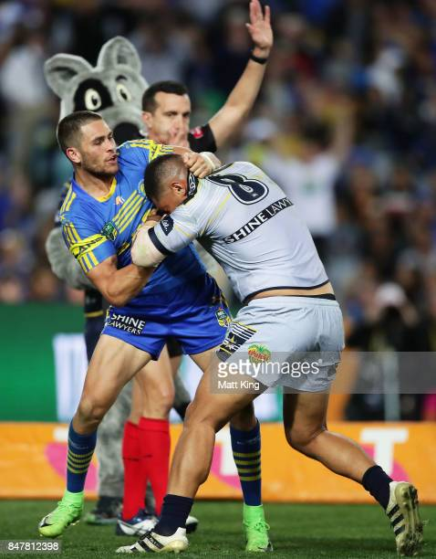 Will Smith of the Eels and John Asiata of the Cowboys wrestle after the try to Coen Hess of the Cowboys during the NRL Semi Final match between the...