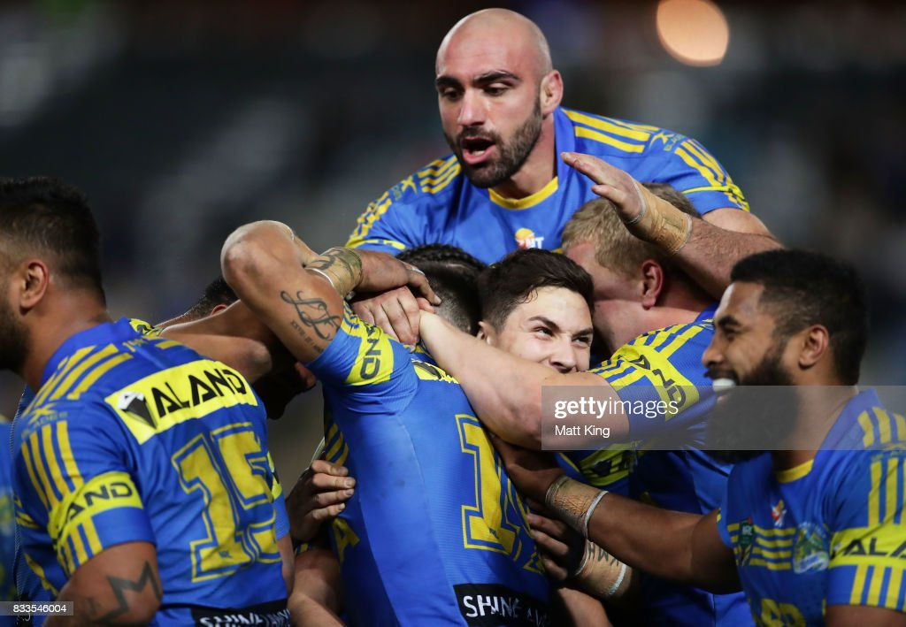 Will Smith of the Eels celebrates with team mates after scoring the final try as Tim Mannah of the Eels jumps over the top during the round 24 NRL match between the Parramatta Eels and the Gold Coast Titans at ANZ Stadium on August 17, 2017 in Sydney, Australia.
