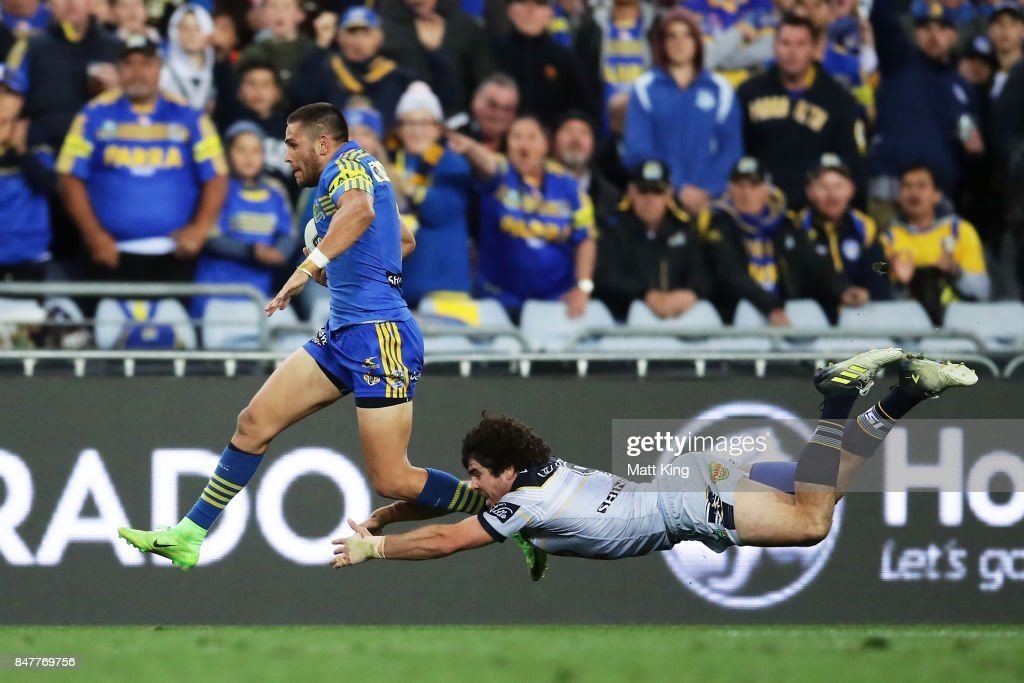 Will Smith of the Eels makes a break and beats the tackle of Jake Granville of the Cowboys to score a try during the NRL Semi Final match between the Parramatta Eels and the North Queensland Cowboys at ANZ Stadium on September 16, 2017 in Sydney, Australia.