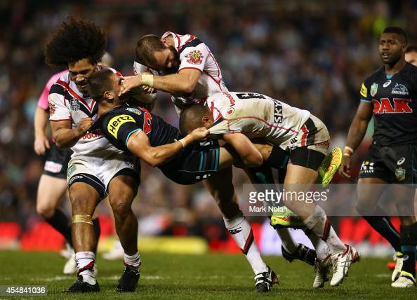 Will Smith of the Panthers is tackled during the round 26 NRL match between the Penrith Panthers and the New Zealand Warriors at Sportingbet Stadium...
