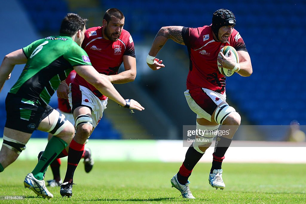 Will Spencer of London Welsh makes a break past David Sisi of Leeds Carnegie during the Greene King IPA Championship Semi Final match between London...
