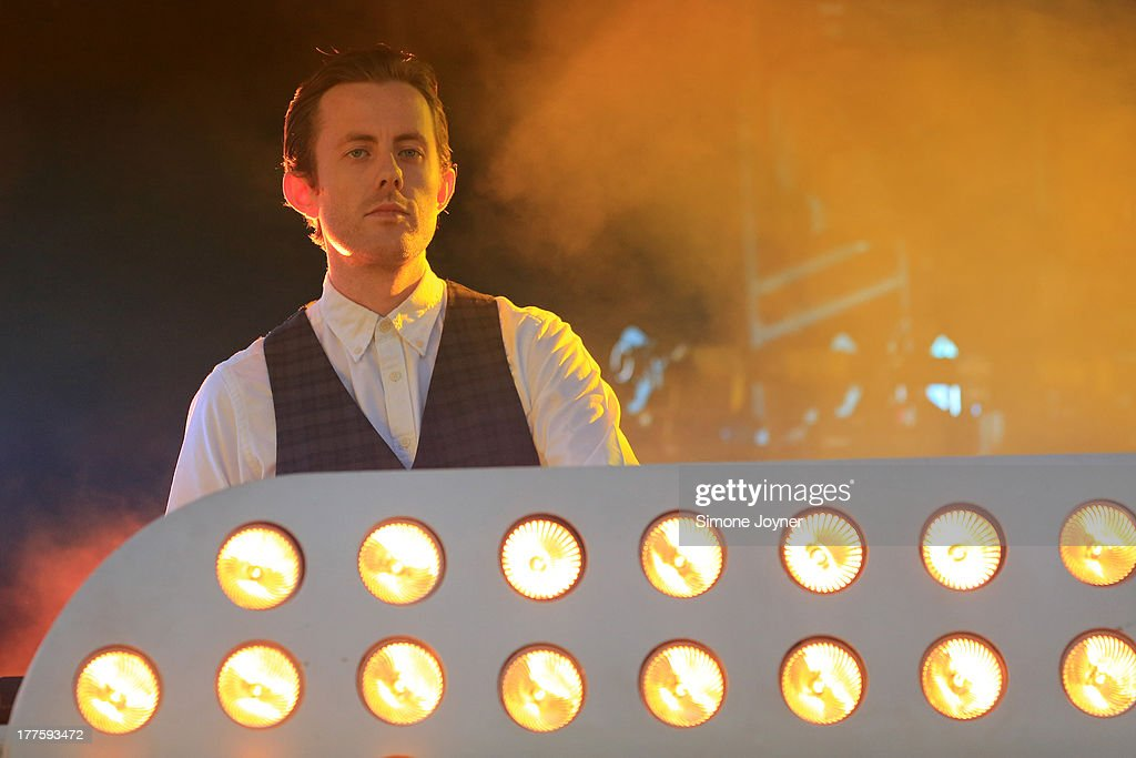 Will 'Status' Kennard of Chase and Status performs live on the main stage during day two of Reading Festival at Richfield Avenue on August 24 2013 in...