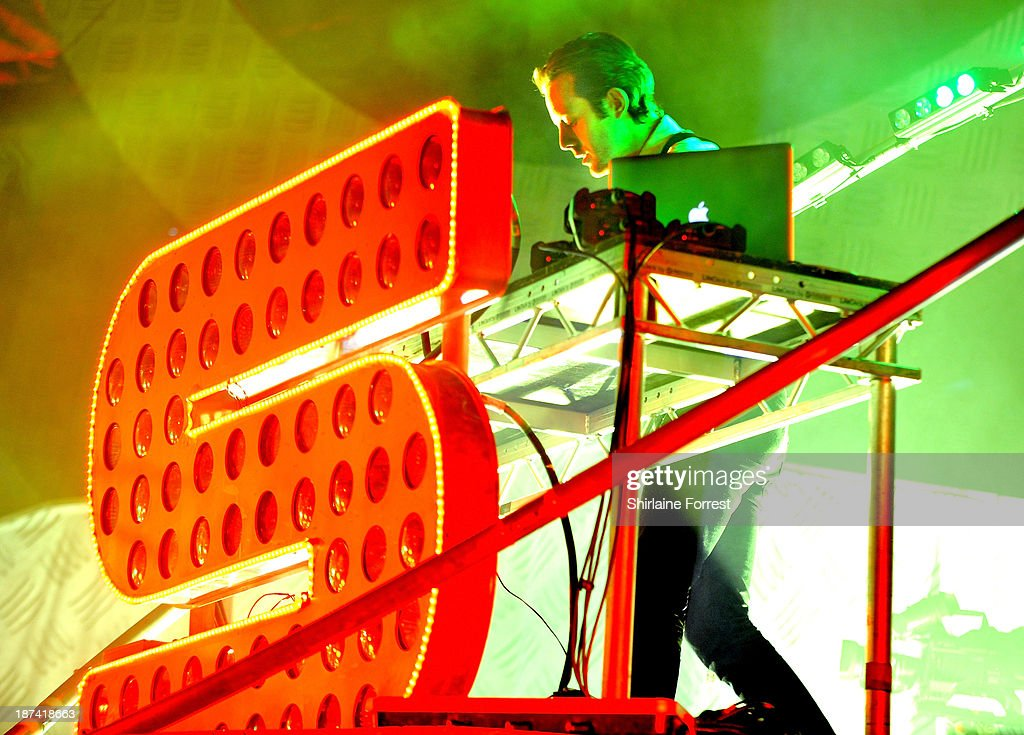 Will 'Status' Kennard of Chase and Status performs on stage at Phones 4 U Arena on November 8 2013 in Manchester United Kingdom