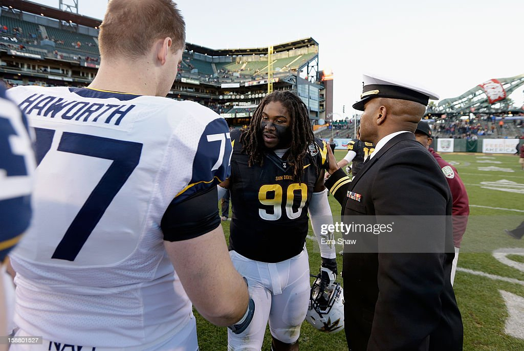 Will Sutton #90 of the Arizona State Sun Devils is congratulated by Beau Haworth #77 of the Navy Midshipmen after the Sun Devils won the Kraft Fight Hunger Bowl at AT&T Park on December 29, 2012 in San Francisco, California.