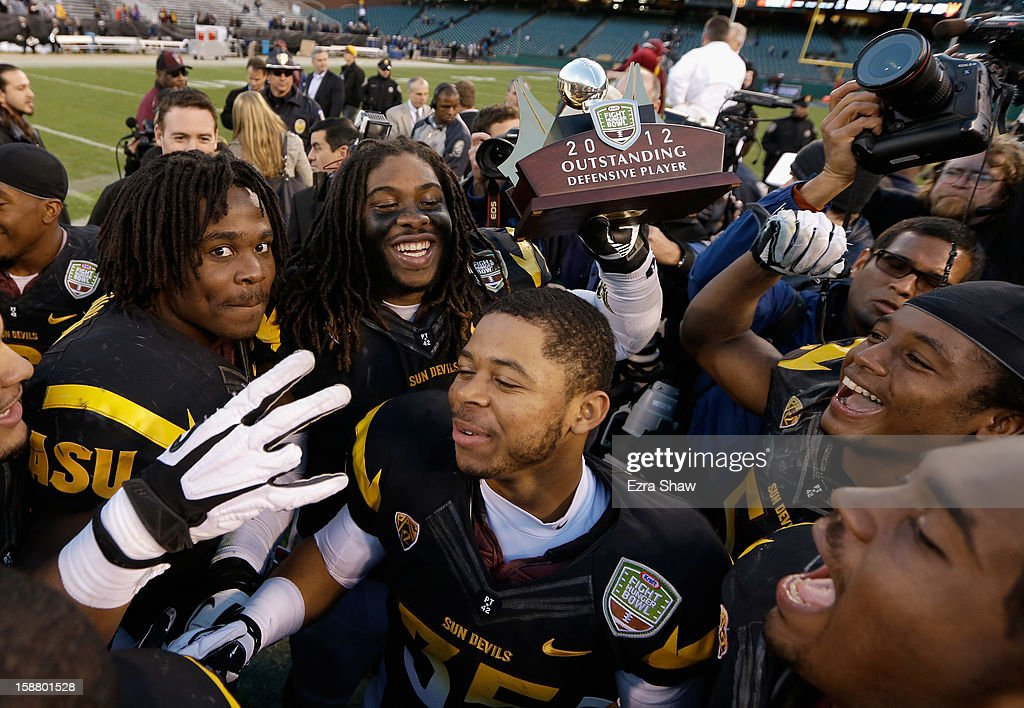 Will Sutton #90 of the Arizona State Sun Devils, who was named the defensive player of the game, celebrates with teammates after they beat the Navy Midshipmen in the Kraft Fight Hunger Bowl at AT&T Park on December 29, 2012 in San Francisco, California.