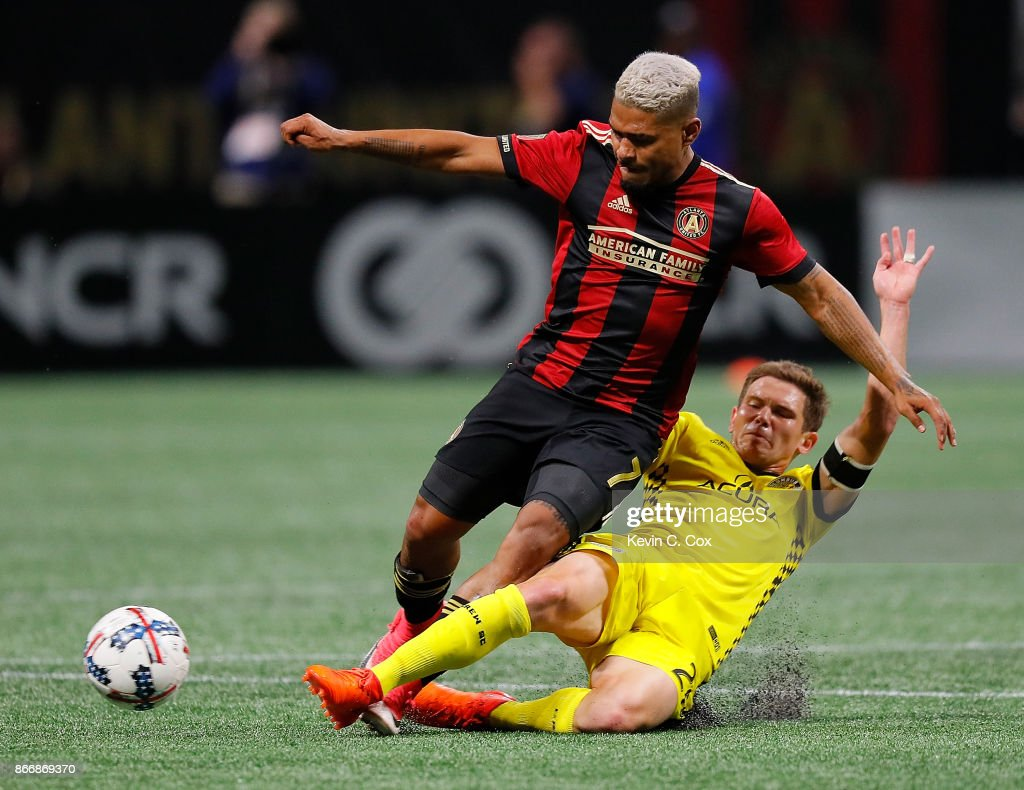 Will Trapp #20 of Columbus Crew challenges Josef Martinez #7 of Atlanta United during the Eastern Conference knockout round at Mercedes-Benz Stadium on October 26, 2017 in Atlanta, Georgia.