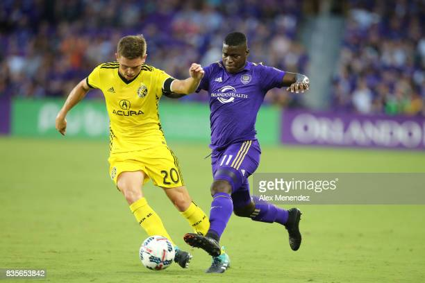 Will Trapp of Columbus Crew SC and Carlos Rivas of Orlando City SC fight for the ball during a MLS soccer match between the Columbus Crew SC and the...