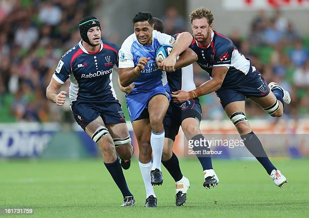 Will Tupou of the Force is tackled by Scott Higginbotham of the Rebels during the round one Super Rugby match between the Rebels and the Force at...