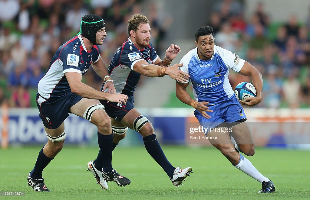 Will Tupou of the Force is tackled by <a gi-track='captionPersonalityLinkClicked' href=/galleries/search?phrase=Scott+Higginbotham&family=editorial&specificpeople=2303432 ng-click='$event.stopPropagation()'>Scott Higginbotham</a> of the Rebels during the round one Super Rugby match between the Rebels and the Force at AAMI Park on February 15, 2013 in Melbourne, Australia.