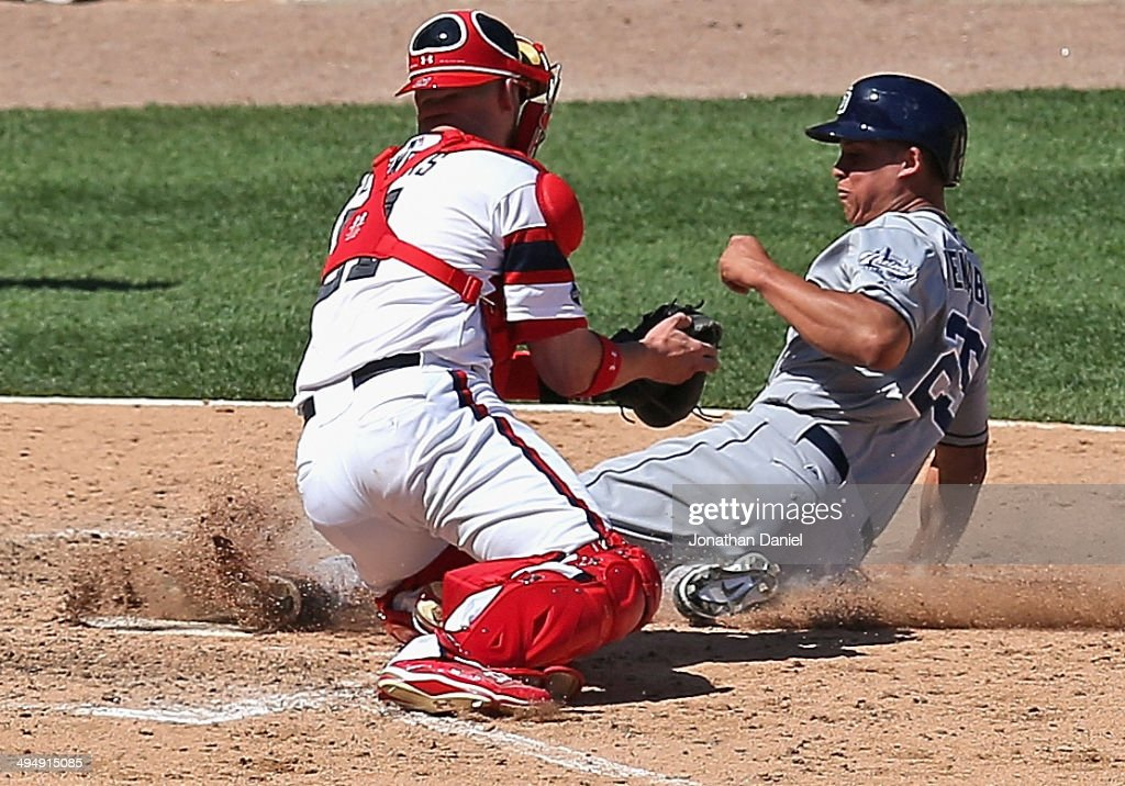 Will Veeable #25 of the San Diego Padres gets his foot to the plate to score a run in the 6th inning before Tyler Flowers #21 of the Chicago White Sox can make the tag at U.S. Cellular Field on May 31, 2014 in Chicago, Illinois. The Padres defeated the White Sox 4-2.
