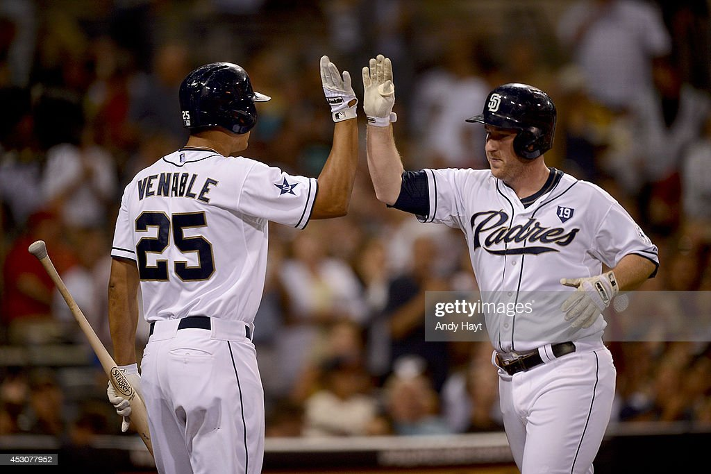 Will Venable #25 congratulates Jedd Gyorko #9 of the San Diego Padres after hitting a home run against the St Louis Cardinals at Petco Park on July 30, 2014 in San Diego, California. (Photo by Andy Hayt/San Diego Padres/Getty Images) Jedd Gyorko;Will Venable