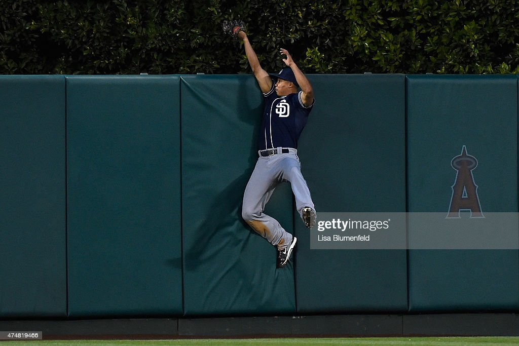 Will Venable of the San Diego Padres catches a ball in the third inning hit by Mike Trout of the Los Angeles Angels of Anaheim at Angel Stadium of...